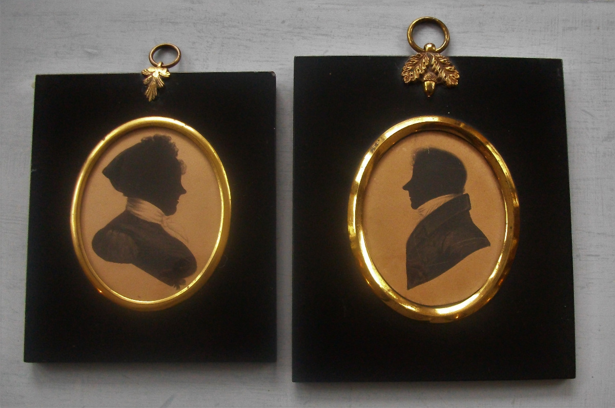 A lovely pair of Husband and Wife Silhouettes painted on card