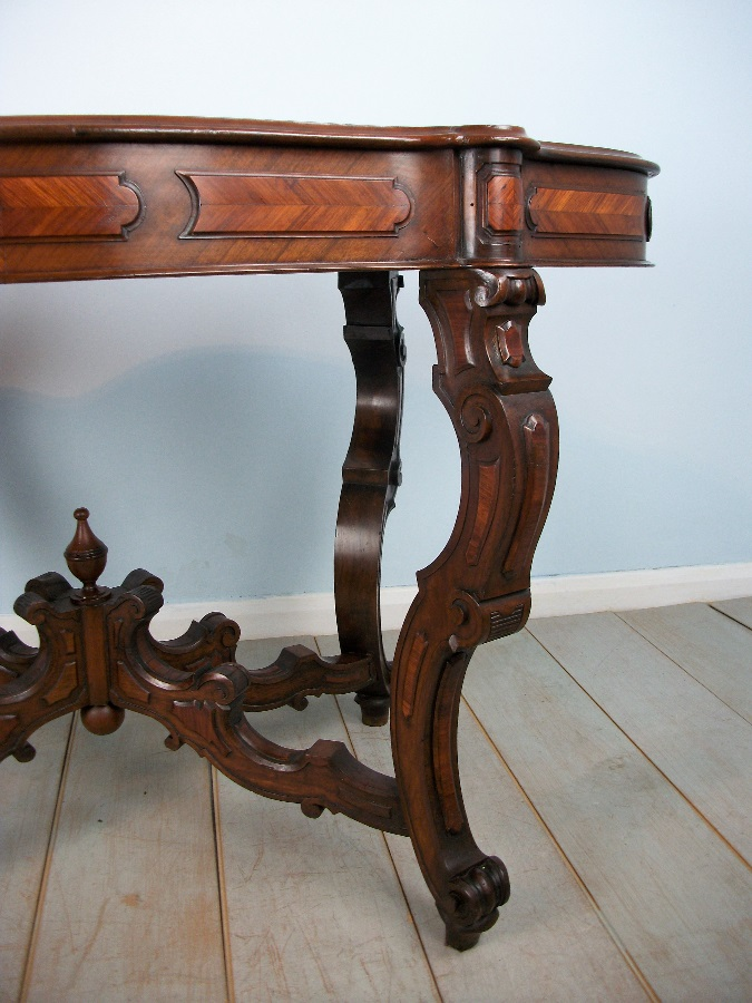 Antique Italian Occasional Table with profusely carved and shaped legs