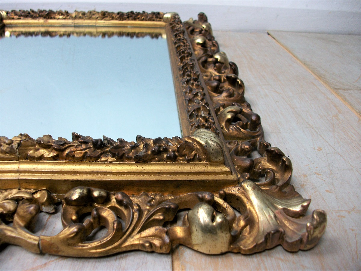 Florentine gilded carved and foliate scroll frame