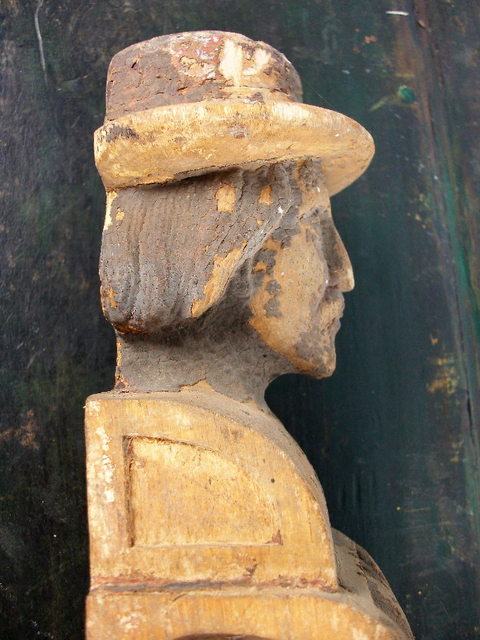 Man with Hat Carving with traces of paint