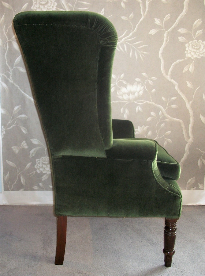 antique wing back armchair