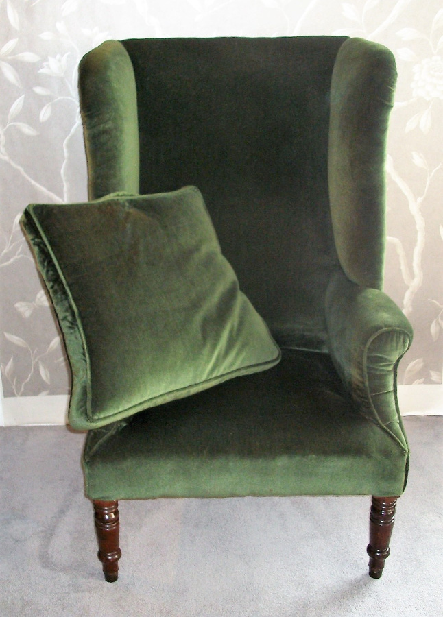 large antique wing back armchair