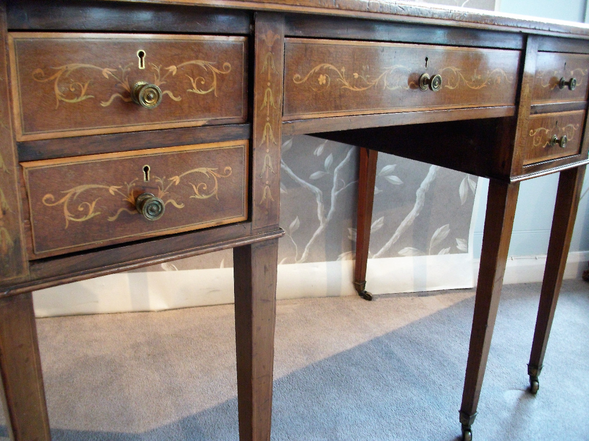 mahogany inlaid writing table with delicate ribbon and foliage inlay