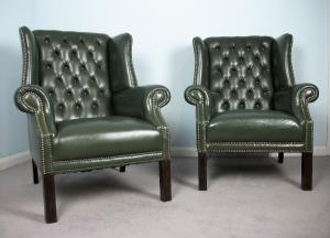 pair of green leather armchairs