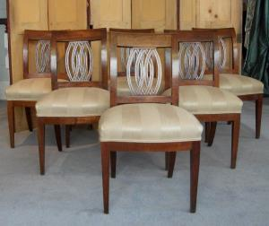 An unusual set of six walnut Italian dining chairs