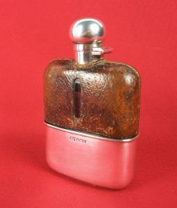 silver and leather bound hip flask